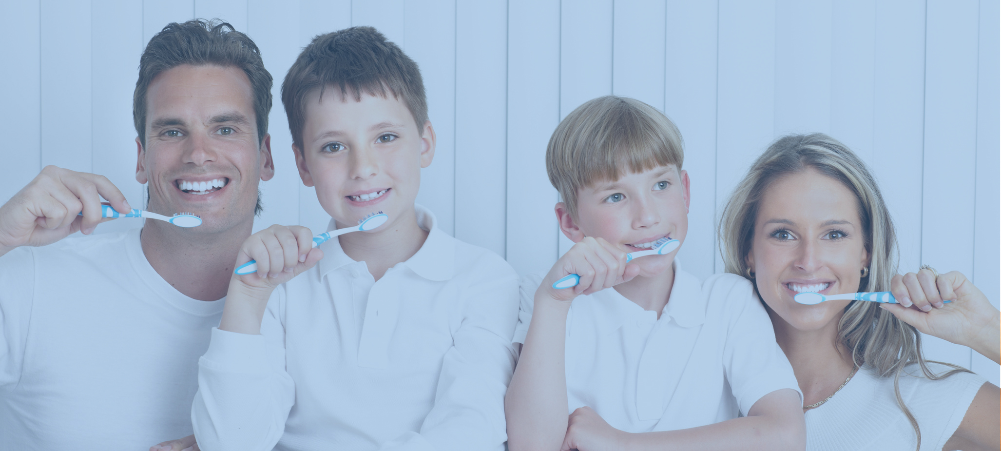 Happy family. Father, mother and children with toothbrushes.